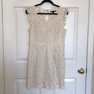 Cream colored, lace-illusion dress